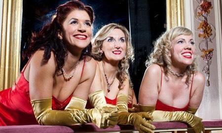 Three women in red satin dresses