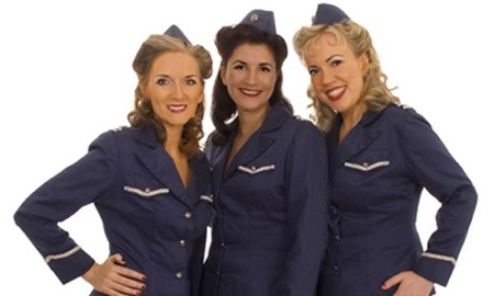 Three woman in blue airforce uniforms 1940s