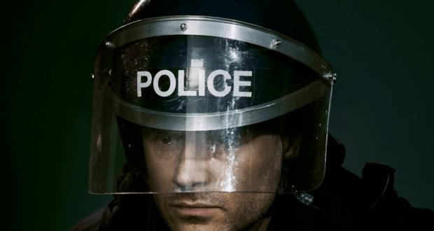 man in police riot helmet